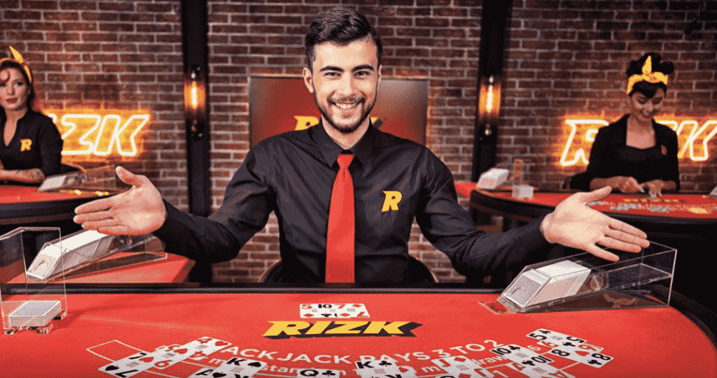 Rizk live casino blackjack table - dealer waiting for the decision of players